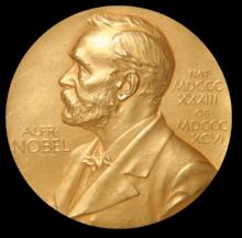 Sir W. H. Bragg and W. L. Bragg share Nobel Prize
